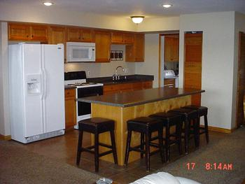 This newer Kitchen features a bar/gathering area.  The refrigerator, oven/range and microwave are included. (photo 3)