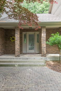 The brick paver walk leads to the front entry that greets guests family and friends with a warm welcome.   Once inside, the center entry hall provides access to the entire home without undue traffic through other rooms. (photo 4)