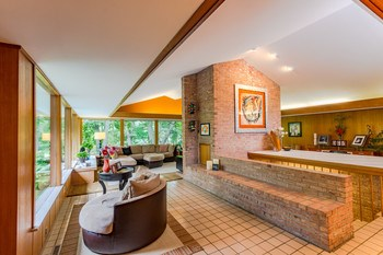Choose a formal dining area or sitting area in this tiled space with wall of windows!! (photo 3)