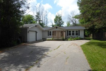 A little piece of heaven can be found in Midland!  This 2 bedroom, 2 bath home is a welcome retreat from a busy life!  It features new paint through out and a new roof in 2017, a private lot just minutes from Midland, but is still inside the city limits. (photo 1)