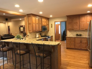 Beautiful kitchen with wood floors, custom cabinetry, granite tops and tile backsplash - just updated in 2015. (photo 2)