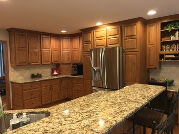Newer stainless appliances too including refrigerator, gas range, microwave and dishwasher.   Wonderful storage in the entire kitchen. (photo 3)