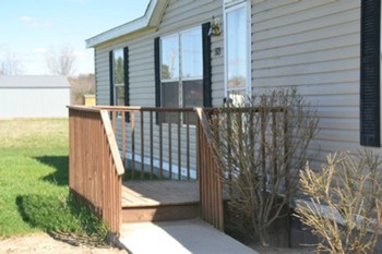 The front entrance has a small deck porch.  The rear of the home has an additional deck. (photo 2)