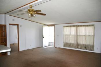From the front entrance you enter into the Living room area.  There is a picture window overlooking the front yard and vaulted ceilings.  A nice open space that is perfect for gathering with family and friends. (photo 3)