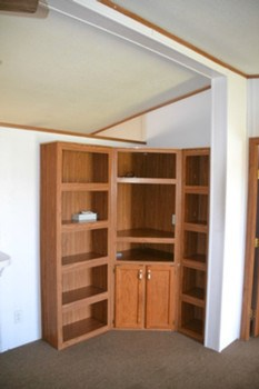 In the corner of the Living room is a built in cabinet.  A good spot to store your trinkets or even book collection. (photo 4)