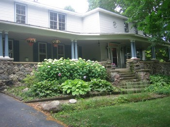 Large porch welcomes neighbors and friends OR great for watching the world go by! (photo 4)