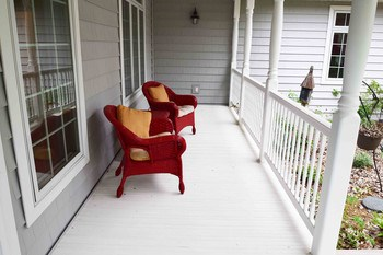 What a great shady spot to sit on those long summer days at the lake. The sitting porch is awonderful place to greet your guests. (photo 2)