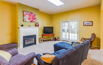 Here comes the Sun!  The living room is a warm, welcoming space. (photo 4)