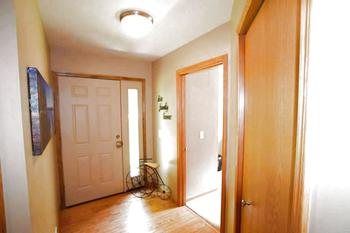 The front entry features wood floors with a generous sized coat closet.  Plenty of space to welcome family and friends into your home.  The home recently had new exterior doors installed. (photo 3)