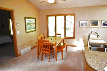 Off to onside of the living room space is the dining room.  Plenty of room for friends and family to gather.  The side window all plenty of natural light into the space and give you a view of the vacant lot next to the home. (photo 5)