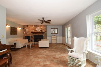 The family room has a tiled floor and a great fireplace insert to keep everyone cozy in the winter. (photo 4)