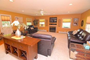 Huge family room for all your entertaining needs... slider to the deck as well (photo 2)