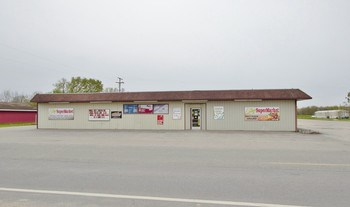This well-established, year-round business with attached home is the perfect investment opportunity! Everything is set up for turn key operation of this 5000 Sq ft market/convenience store plus so much more. It currently serves as a gas station, meat market, hot food & pizza take out, as well as convenience items. Beer, wine, lotto sales as well as hunting and fishing licenses. The sale will include various convenience store equipment. (photo 1)