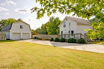 Pinconning Twp. updated home with an awesome 28x40 garage with a heated upstairs