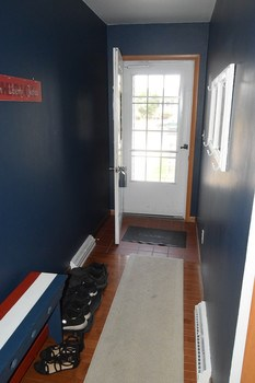 Once inside the home has a great entry that gives you ample room for a stool to use for removing your shoes.  There is a good sized coat closet right in the hallway. (photo 4)
