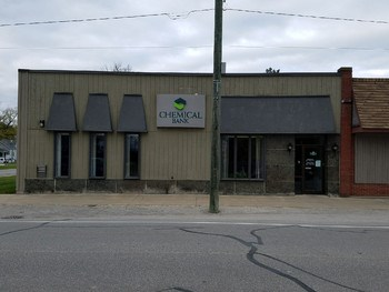 Lots of potential for this property located in the Walleye fishing capital of Michigan! Currently used as a location for Chemical Bank, this property is zoned as Neighborhood Commercial C1 and presents many possibilities! The potential for this location is huge and could include retail businesses like a bait/tackle shop or trading post, a restaurant, office space for retail or government, medical or dental practice, etc. This particular lot is huge; don't let this opportunity slip through your fingers. Call for your private showing today! (photo 1)