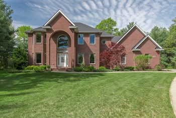 AN ELEGANT COUNTRY FEELING WITH A PRESTIGIOUS PRESENCE!   This home is in a country subdivision close to city conveniences.   This is a custom built home by Wright Builders where QUALITY IS kING. Approximately 3183 sq. ft. this 5 bedroom, 4.5 bath home is on a cul de sac and in an area of fine custom homes.   Some of the many features include an AMAZING kitchen, breakfast dining, adjoining great room, main floor laundry, sitting room (or formal dining), office/den.  The 4 bedrooms on the 2nd level all have private bath access.   A formal and a family stairway lead to the 2nd level.  The finished lower level (1138 sq ft) includes a kitchenette, dining area, 5th bedroom, full bath, and media room.   The Reder  professionally designed and installed back yard offers it own entertaining paradise with the Azek decking, paver patios, glass-topped gas fire pit, water feature, gas grill, sunken hot tub, and sound system. Modern as tomorrow, this is a home you will be proud to own and love. (photo 1)
