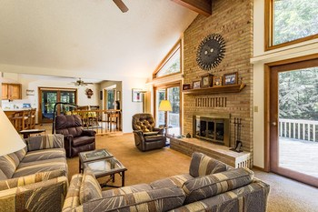 What a great space!  The living area opens to the large deck, the formal dining room and the informal dining space off the kitchen.  Truly the hub of the home!  Gas fireplace too for winter nights. (photo 2)