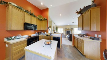 View from kitchen to great room shows how open the home is. (photo 4)