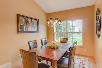 Spacious formal dining room fits a nice size table great for family holidays. (photo 5)