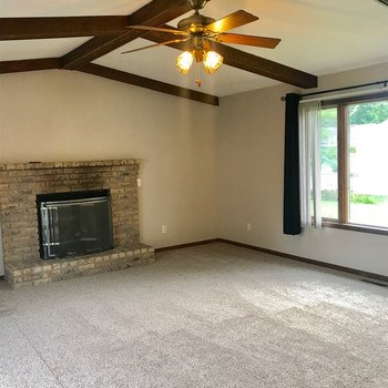 Spacious family room with gas log fireplace. (photo 4)