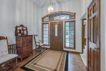 Lovely, inviting foyer with hardwood floors! (photo 4)