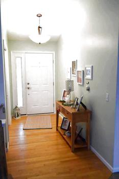 The front entrance  has wood flooring and an oversized coat closet.  The entry open into the main living space of the home. (photo 4)