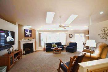 The Large Great room is the perfect spot for gathering.  It is just off the main entrance and open to the dining and kitchen spaces.  Plenty of natural light coming in with the full wall of windows that face the East.  The room also features double skylights so it stays nice and bright all the time. (photo 5)