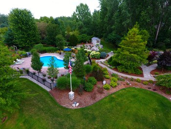 Meandering pathways lead to the pool area which is separately fenced. (photo 3)