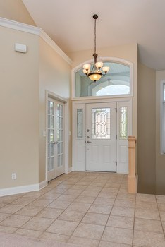 This spacious foyer will welcome you to this comfortable home. (photo 2)