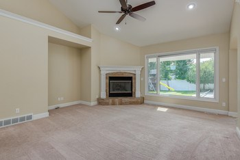 Great Room with cathedral ceilings and a beautiful view of the back yard. (photo 3)