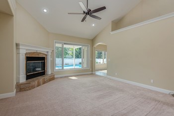 Great Room with gas-log fireplace. (photo 4)