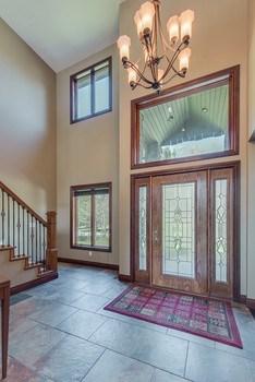Elegant 2 story foyer with beautiful tile floors. (photo 5)