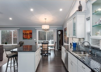 You'll love preparing meals in this open kitchen, complete with all Whirlpool appliances! (photo 3)