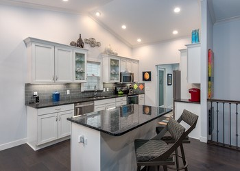 There isn't an inch of counter-space in this home that doesn't house quality granite from from Capital Granite. (photo 5)