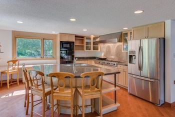 This gourmet kitchen features granite counter tops, stainless appliances and 27,000 BTU Viking WOK stove with Gen Air range included. (photo 2)