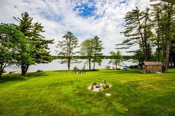 The lot softly slopes down to the stunning lake front, perfect for campfires, lawn games, or just kicking back and watching the boats go by. (photo 3)