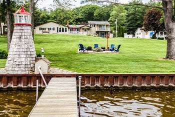 The home sits back off the lake giving you a ton of space to entertain! A new dock lift in 2015 and updated landscaping will make it easy to sit back and enjoy all this lake house has to offer. (photo 4)