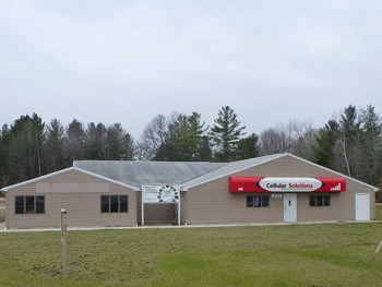 Income producing Commercial Buildings on 3 acres, high traffic area near US10/M30 interchange. Main bldg is 5,600 sq. ft. separated into 3 suites & currently has a long time tenant in one.  Small building houses a Beauty Salon. Plenty of room to add storage units. (photo 1)