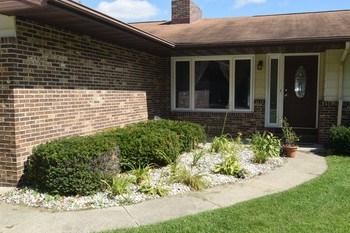 The covered front porch is the perfect spot to great your guest.  They can enjoy the landscaping that is already established along the walk way to the front entrance. (photo 2)