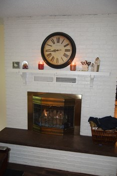 The gas fireplace has a mantle and a nice hearth. (photo 4)