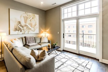 Expansive Marvin windows flood the space with natural light and provide gorgeous views of the river and surrounding city scape. Wood flooring runs throughout the living room adding to the open feeling of this stunning space. (photo 2)
