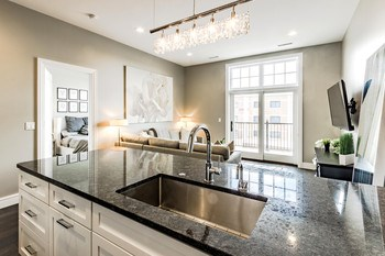 Clean up seems like less of a chore in this fabulous kitchen with views out to the balcony. The kitchen was carefully laid out with lots of useful storage. (photo 4)
