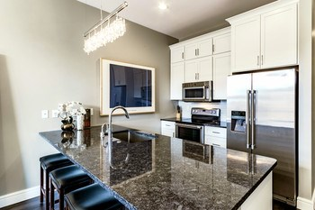 Newly constructed in 2015 this kitchen has all the upgrades including custom cabinetry, granite counters, stainless steel Energy Star rated appliances, and beautiful high-end fixtures. (photo 5)