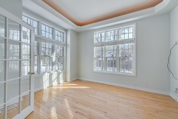 Living room or den off the foyer with maple floors and natural light. (photo 3)