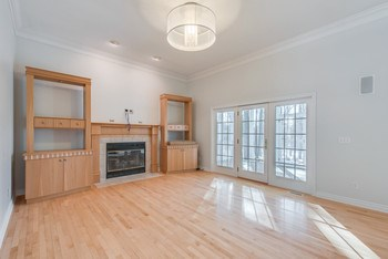 Great Room with fireplace and maple floors (photo 4)