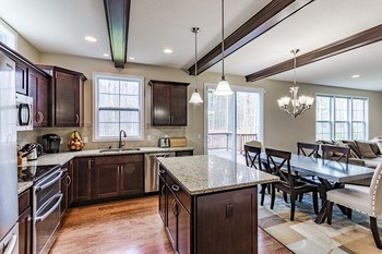 The wood beams add a custom design element while the gorgeous granite counter tops, wall of windows and open floor plan add to the ambiance of this stunning home. (photo 4)