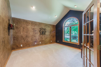 This is a view of the room empty.............it can be used as a Living Room, Den, or Music Room. (photo 5)