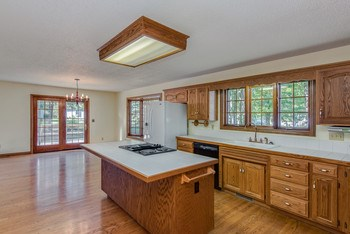 Fabulous, fully equipped kitchen with a snack bar for your family and friends to gather. Large informal dining area with French door accessing deck and back yard. Hardwood flooring. (photo 5)