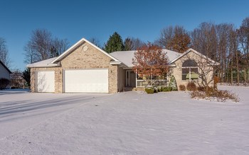 GORGEOUS brick ranch, quality built by RB Harsh in Siebert area & much desired open floor plan on beautifully landscaped lot.  Features 2491 sq ft with 4 bedrooms, 3 full baths and one-half bath, vaulted ceilings in the spacious living room and a cozy gas-log fireplace. This wonderful home also includes a 15x14 sunroom,  hardwood floors, large composite deck & paver patio, main floor master suite, main floor laundry, A/C, sprinklers, full finished basement w/ wet bar, family room, egress window & tons of storage throughout! Brand new gorgeous granite counter tops and a freshly painted kitchen and dining area! Don't let this forever home go; call to schedule your private tour today!! (photo 1)